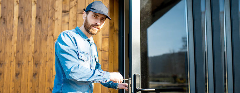 A qualified locksmith fixing a door.